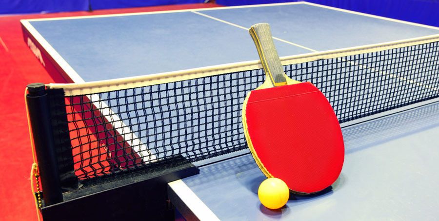 A tabletennis bat and ball